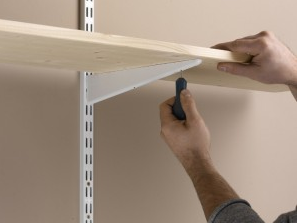 Securing the twin slot shelving shelves to the brackets and uprights